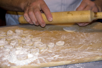 The cook is prepared with a dough for ravioli