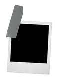 single photo frame taped, minimal shadow behind poster