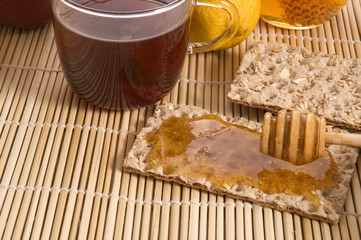 sweet breakfast ingredients - bread, honey, fruits, tea
