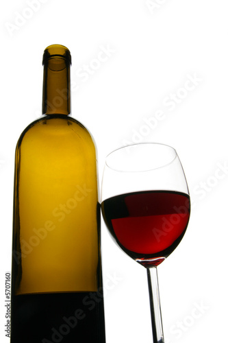 Glass and bottle of red wine isolated over white background