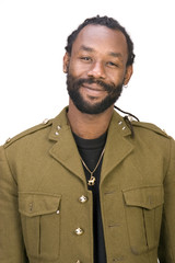 A Black man in a Army jacket isolated on a white background.