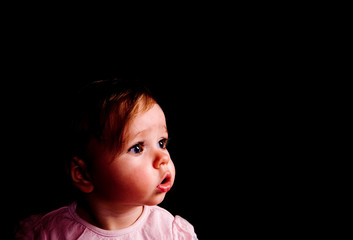Brave baby girl looking forward