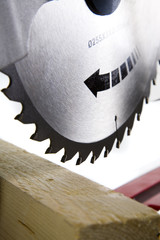 Timber Ready to bo Cut with Mitre Saw, Blade in Focus