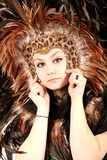 bohemian woman in feather native mask and hat