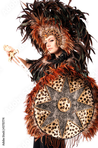 beautiful bohemian woman in leopard and feather native