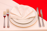 Restaurant. Dinner plate with napkin and a set of flatware. poster