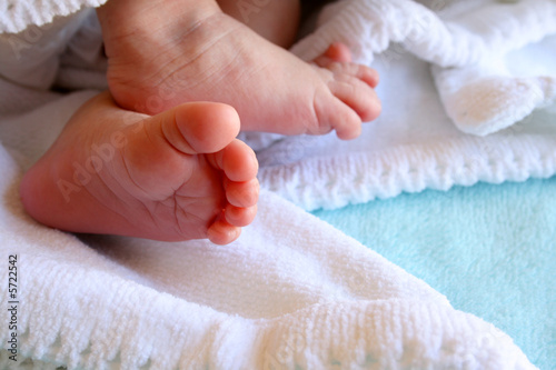 New Born Feet wrapped in a soft white blanket