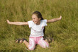 Girl plays on a meadow III