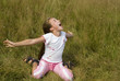 Girl plays on a meadow II