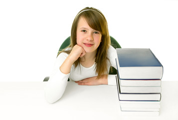 Portrait of Happy young schoolgirl smiling from behind book