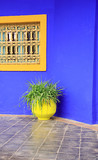 Yellow pot against a vivd blue wall Morocco North Africa. poster
