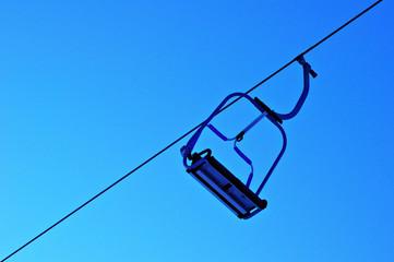 single chair skilift in winter ski resort blue sky