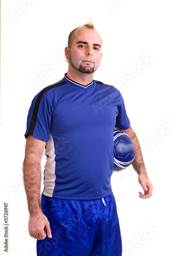 A male soccer player. Studio shot over white.