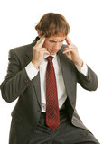Young businessman stressed out with a headache at work.   poster