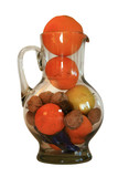 apples, oranges and sweets in a jug on a white background