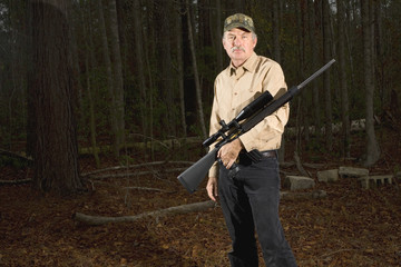 man coming out of the woods with an AR 15