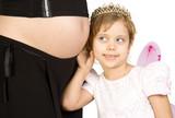 Little fairy listening tummy of pregnant women Isolate on white. poster