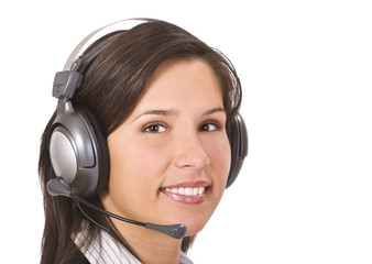 Beautiful smilling brunette with headphones.