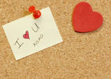 note saying I love you on cork board poster