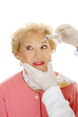 Senior woman having cosmetic injections