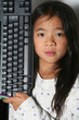 young child - girl- with computer keyboard