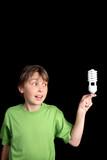 Boy holds an energy efficient compact fluorescent light bulb  poster