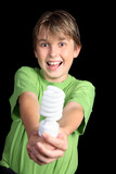 A boy in green t-shirt holding out  energy efficient light bulb poster