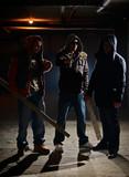 Gang members in a dark alley poster