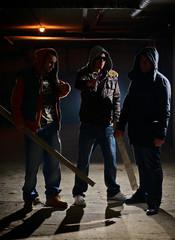 Gang members in a dark alley