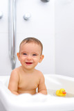 Portrait of a Baby smiling in the bathtub . poster