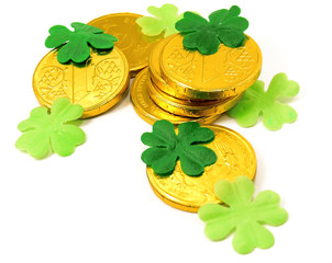 Saint Patrick's Gold and green clover leaves on white background