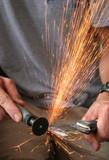 sparks flying from grinder poster