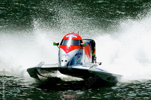 striking hi speed motor boat in action - 5749715