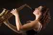 Woman with saxophone in retro lingerie