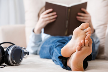 Teenager reading on the couch