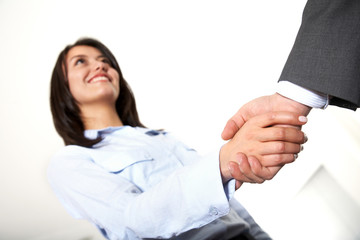 handshake to seal a business deal in an office