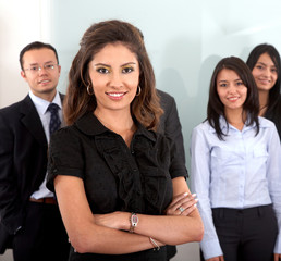 Business team in an office with a businesswoman leading
