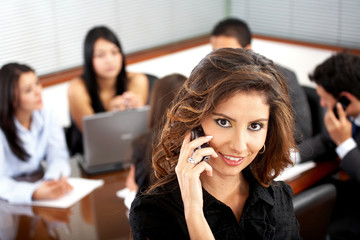 business woman on the phone during an office meeting
