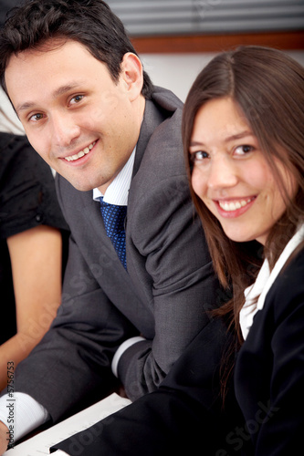business people smiling in an office environment