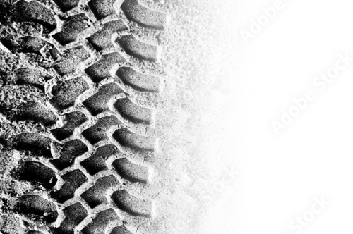 canvas print picture Tyre tread pattern in sand with area of copyspace