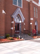 red brick church and sidewalk