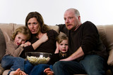 Family watching scary movie poster