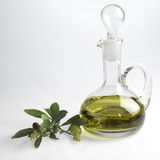 Fototapety bottle with fine olive oil and a branch of an olive tree