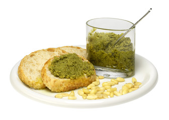 sliced bread with pesto sauce and pine-tree seed