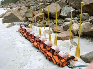 lifejackets and oars lined up for rafting, rishikesh, india