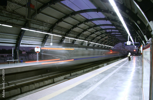 metro zooming past station, delhi, india - 5780119