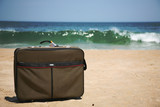 Conceptual shot of a suitcase on the beach poster