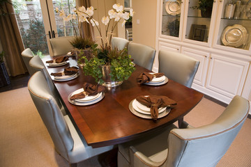 Dining room and table with luxurious decor.