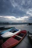 old boat on frozen river Danube in january poster