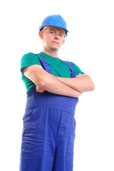 Builder wearing blue jumpsuit and helmet posing over white
